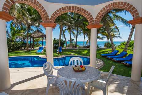 Poolside patio at Villa Margaraita vacation rental villa on the Riviera Maya