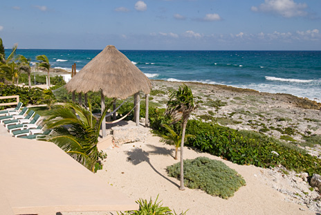 View of the coastline in front of Villa Nicte Ha on Half Moon Bay Akumal Mexico