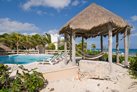 Villa Nicte Ha has a poolside palapa on Half Moon Bay