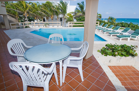 Poolside patio at Villa Nicte vacation rental property