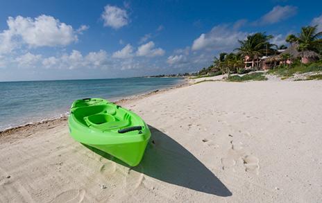 Beach and sea kaya in front of Villa Orquidea 5 BR vacation rental villa on Tankah Bay
