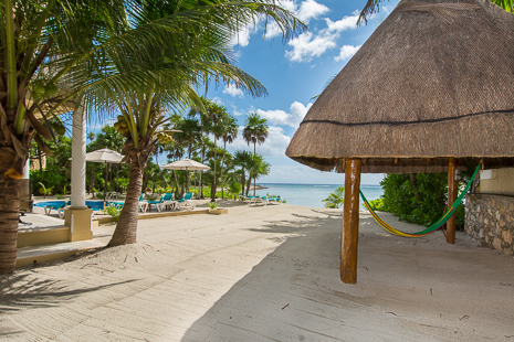 "A seaside palapa houses beach ""toys"" for guests of Villa Orquidea"