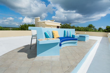 A sofa on the rooftop of Villa Orquidea vacation rental villa in Tankah