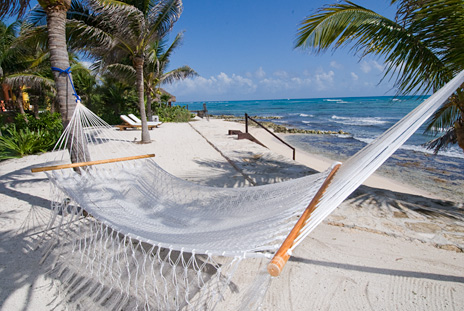 Seaside hammock on Jade Beach at Villa Palmilla luxury rental home, Akumal