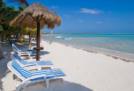 Pristine beach at Villa Palmeras Soliman vacation rental villa on Soliman Bay
