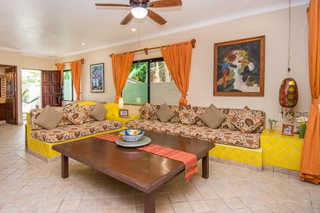 Living room seating area at Villa Palmeras Soliman vacation rental home on Soliman Bay