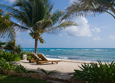 Beach lounge chairs on Jade Beach at Villa Palmilla luxury rental villa near Akumal