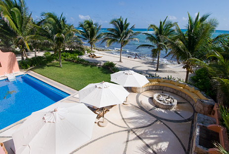Views of the pool and ocean at Villa Palmilla vacation rental villa near Akumal