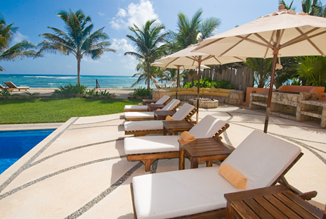 Lounge chairs poolside at Villa Palmilla Akumal vacation rental villa