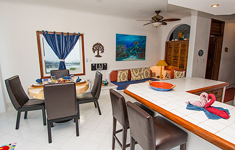 Dining area and Living area of Playa Caribe #5, Akumal vacation rental villa on Half Moon Bay