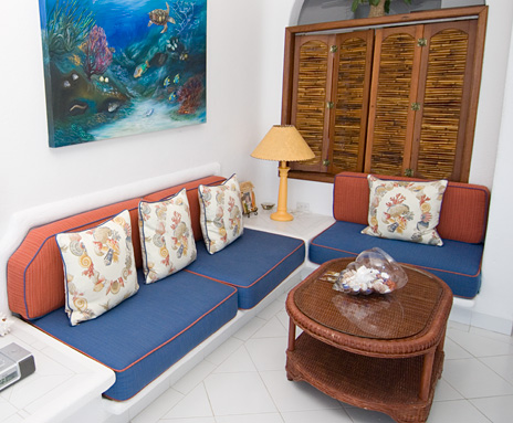 Living area of Playa Caribe #5, Akumal vacation rental villa on Half Moon Bay