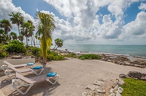 Beach chairs at Villa Pelagia vacation beach rental on tankah bay, riviera maya, mexico