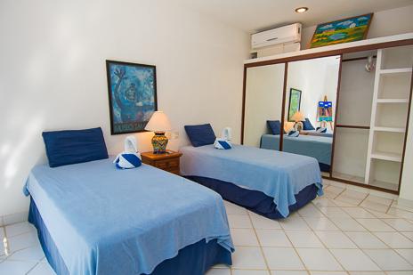 Bedroom #5  at Los Primos South Akumal vacation rental villa is in the guest house