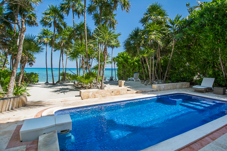 View of the pool toward the ocean at  Los Primos South Akumal vacation rental villa