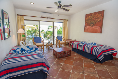 TV room and bedroom at Los Primos South Akumal vacation rental villa