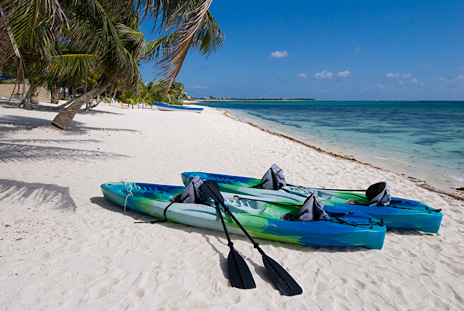 Beautiful beach along Tankah Bay and kayaks for exploring the bay