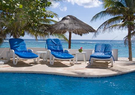 Lounge chairs along the pool at  Casa Salvaje Akumal Aventuras vacation rental villa