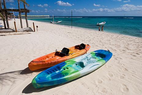Sea Kayaks  in front of Casa Salvaje Akumal Aventuras vacation rental villa