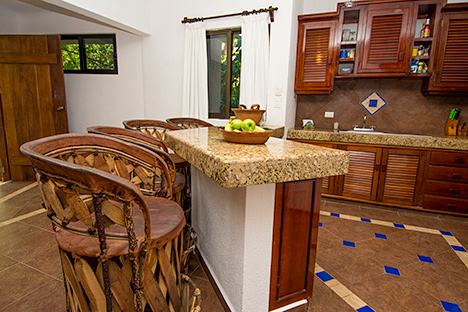 Kitchen lunch counter at Casa Salvaje Akumal Aventuras vacation rental villa