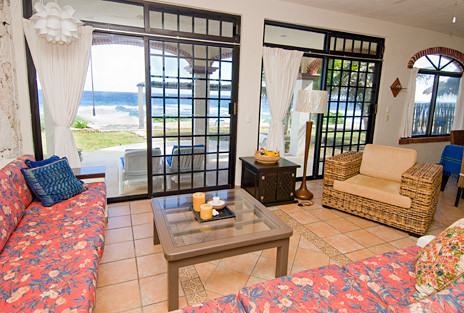 Sliding glass doors from living room to ocean at Sea Gate  4 BR Akumal vacation rental villa on the Riviera Maya