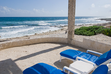 Oceanfront lounge chairs on the patio at Sea Gate  4 BR Akumal vacation rental villa on the Riviera Maya