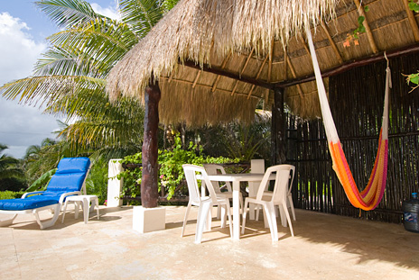 Palapa patio with hammocks at Sea Gate  4 BR Akumal vacation rental villa on the Riviera Maya