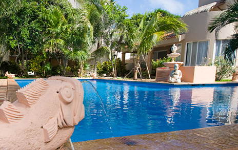Fish fountains around the swimming pool at  the Sirena Iguana vacation rental villas and condos