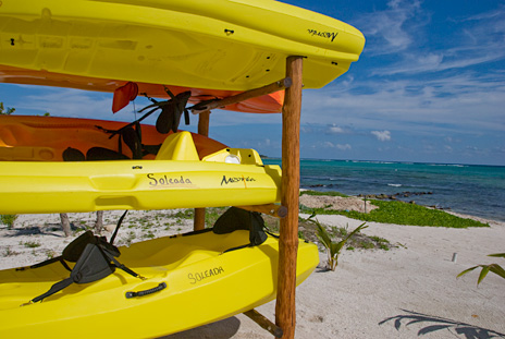 A rack of sea kayas away at  Casa Soleada vacation rental property south of Akumal