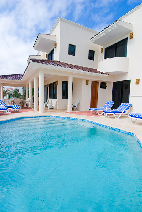 Poolside view  of Casa Soleada vacation rental villa on Tankah Bay