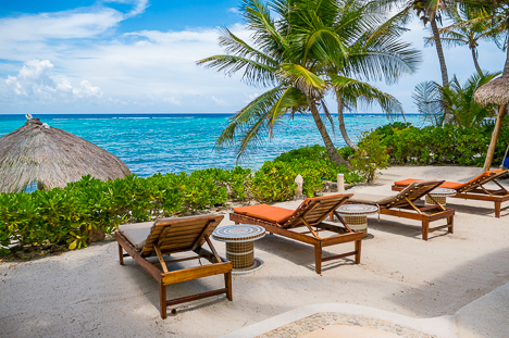 Beach chairs line the beach at Casa Sunrise  2 BR Akumal vacation rental villa