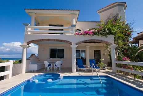 Front Twin Palms and the swimming pool and patio at this Akumal vacation rental villa