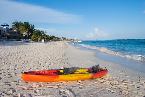 A sea kayak on the beach at U Nah Kin 2 BR Aventuras Akumal vacation rental villas