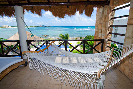 Second floor patio with hammock at Villa de Vallhalla  luxury vacation rental villa in Akumal