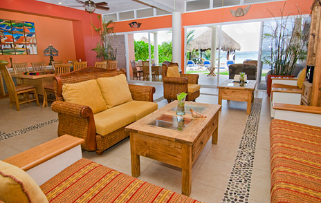 Living room and dining room at  Villa de Vallhalla Akumal luxury vacation rental villa