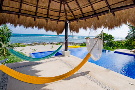 Hammocks in the palapa at Villa de Vallhalla  luxury vacation rental villa in Akumal