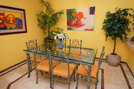 Dining room in 105C rental condo at Villa del Mar luxury condos on the Riviera Maya, Puerto Aventuras, Mexico