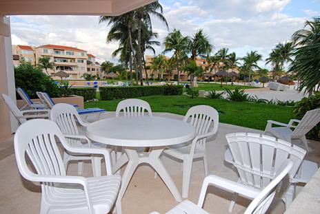 Oceanfront patio in the villa del mar rental condo in puerto aventuras