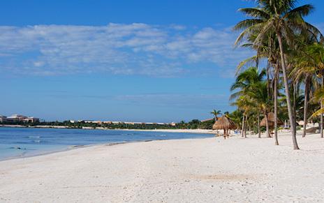 Take a stroll on the beach at villa del mar in Puerto Aventuras
