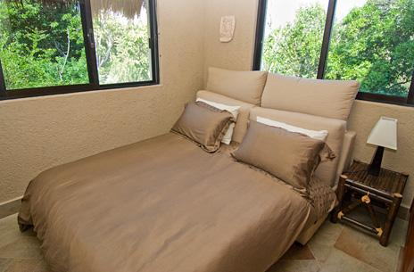 Bedroom #4 and exercise room at La Via 5 BR Akumal vacation rental villa