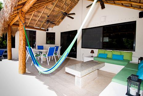 Hammock for siestas under the palapa at  La Via 5 BR Akumal vacation rental property