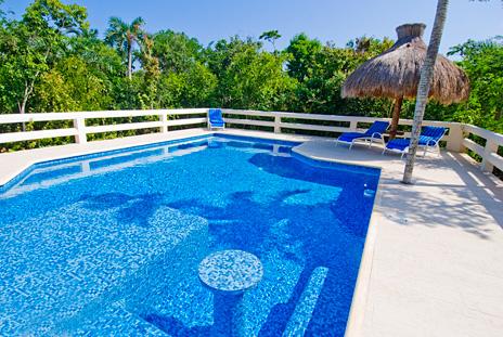 La Via swimming pool and jungle view at this 5 BR Akumal vacation rental villa