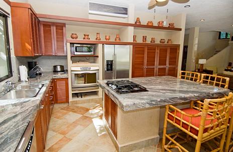 Modern kitchen at La Via 5 BR Akumal vacation rental villa