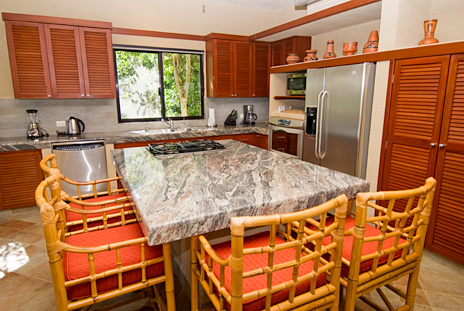 Lunch counter in the kitchen at La Via 5 BR Akumal vacation rental villa