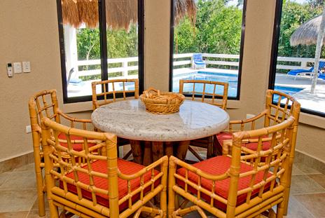 Kitchen dining area at  La Via 5 BR Akumal vacation rental villa