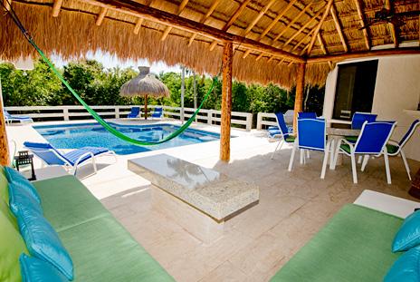 Under the palapa at  La Via 5 BR Akumal vacation rental villa