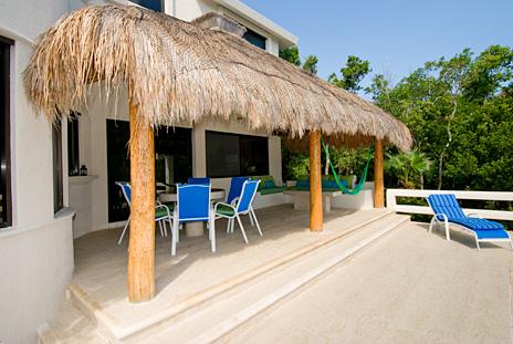 Poolside palapa at La Via 5 BR Akumal vacation rental home