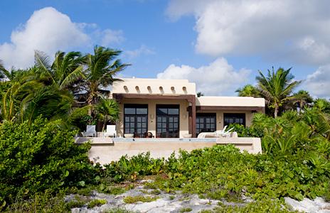View of the exterior from the  lagoon at  Las Vigas 2 BR Akumal vacation rental villa