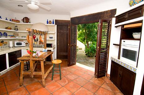 Doors to the courtyard from the kitchen at  Las Vigas 2 BR Akumal vacation rental villa