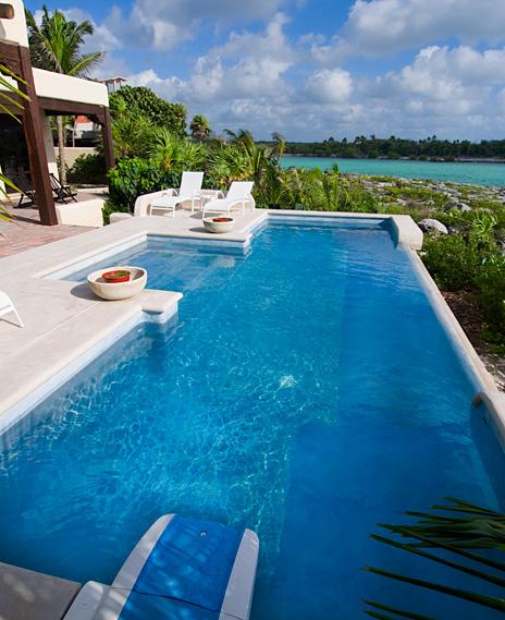Pool along the lagoon at  Las Vigas 2 BR Akumal vacation rental villa