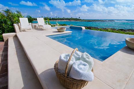 Take a refreshing dip in the private swimming pool at  Las Vigas 2 BR Akumal vacation rental villa